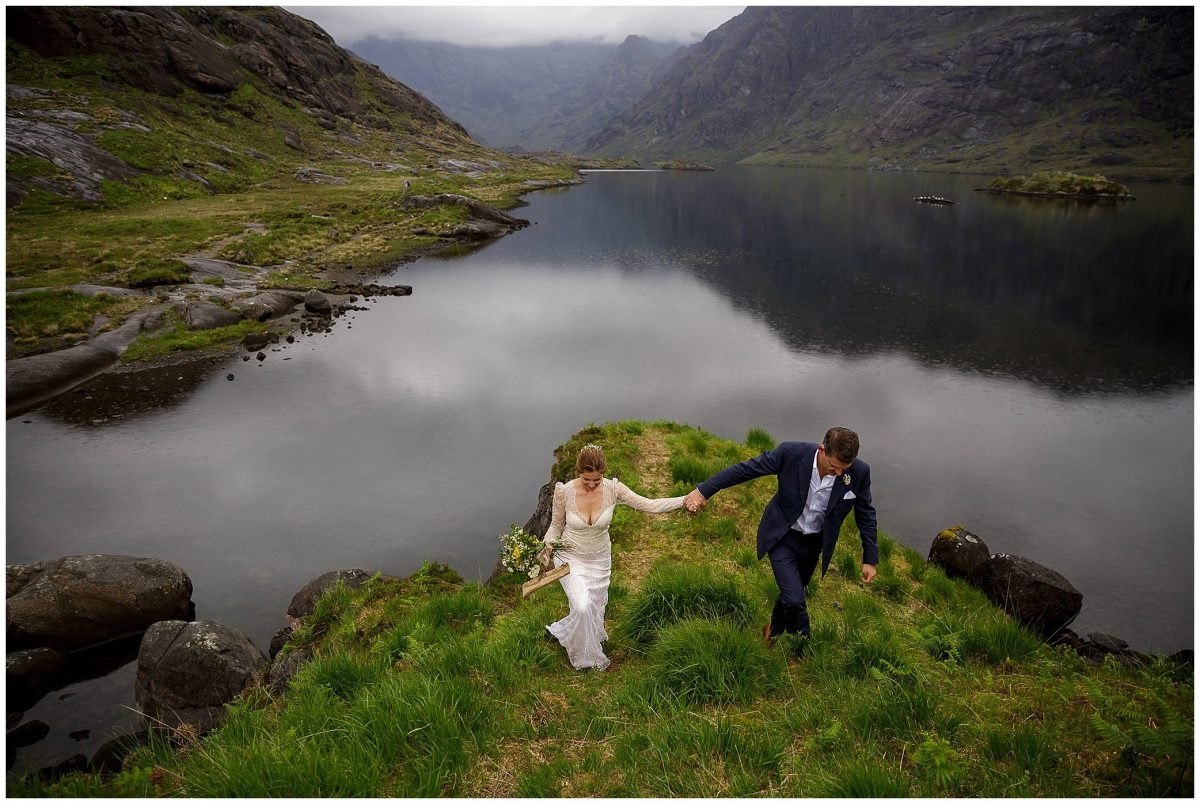 A bride and groom are pictured on the shores of Loch Coruisk after their wedding