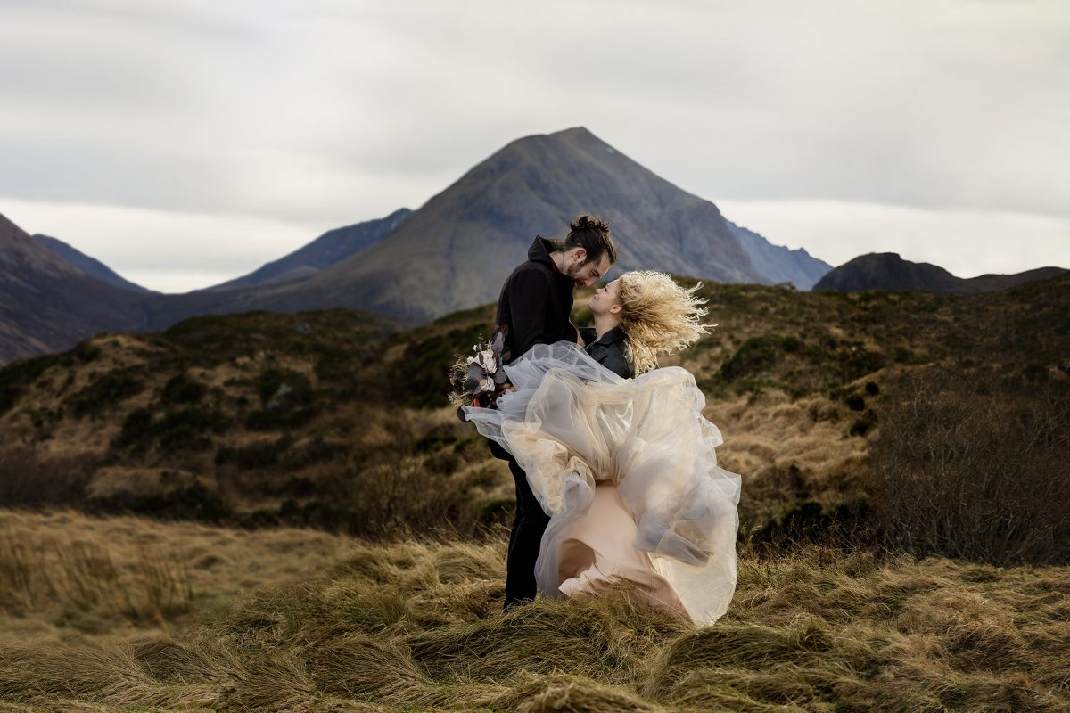 Bride and groom in the wind